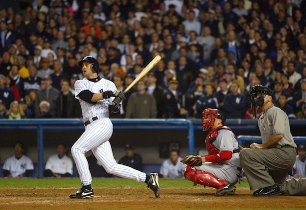 Aaron Boone hits the game winning home run against the Boston Red Sox during game 7 of the American League Championship Series in 2003. (Photo courtesy of Al Bello/Getty Images)