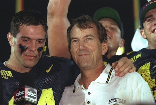 Head coach Lloyd Carr (R) and quarterback Brian Griese after the Wolverines 21-16 win over Washington State in the 1998 Rose Bowl. (Photo courtesy of Getty Images)