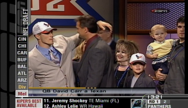 From April 2002 at the NFL Draft: David Carr (far left) celebrates with his family after being picked No. 1 overall by the Houston Texans. Little brother Derek (third from right, white cap) is now a 2014 NFL Draft prospect.  (ESPN)